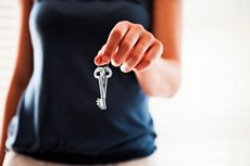 Woman holding the keys to rent out your property