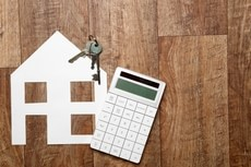 Keys, house, and calculator - valuing what your home is worth